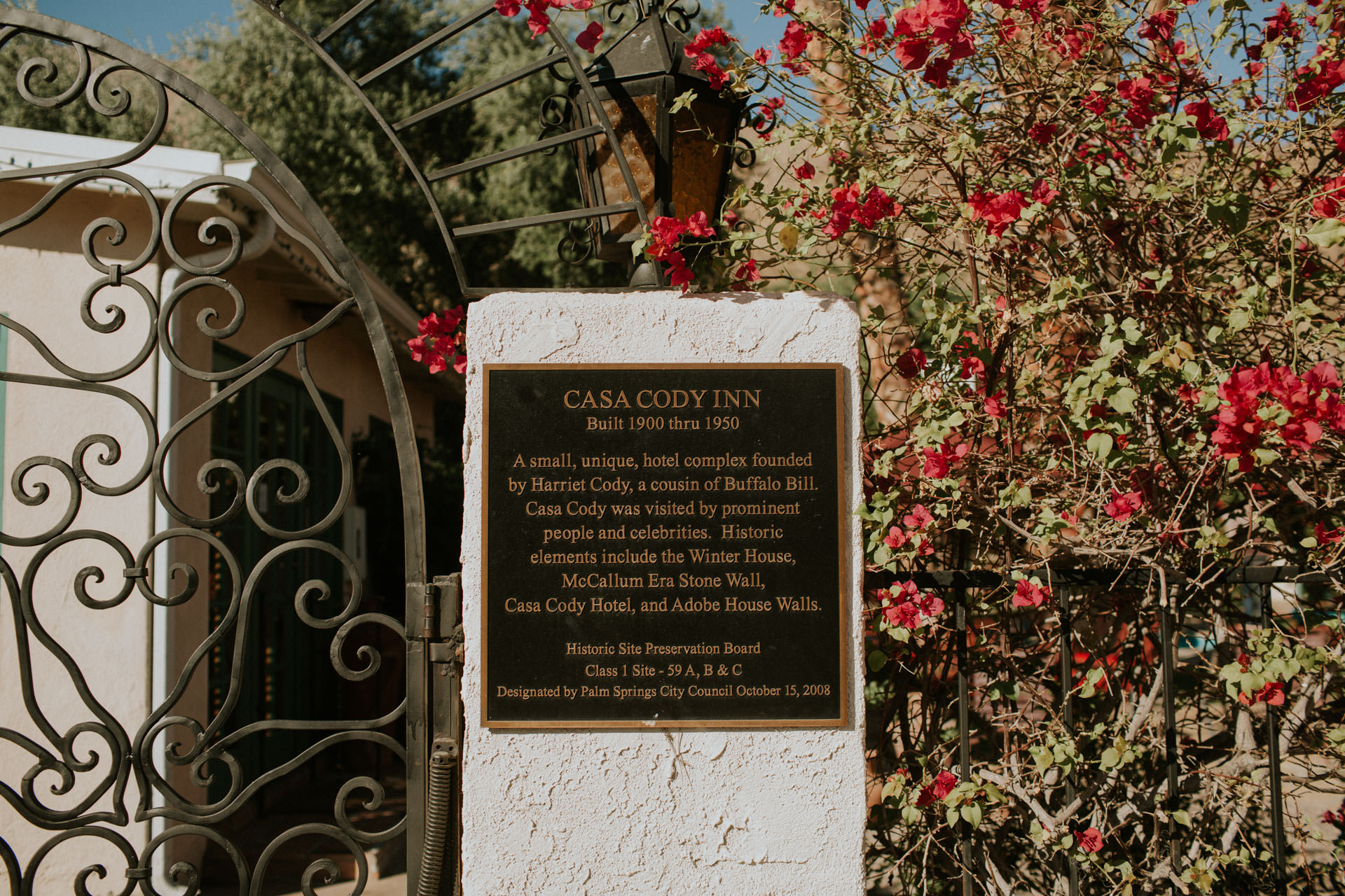 the front entrance of casa cody inn describing it's history and adobe house walls